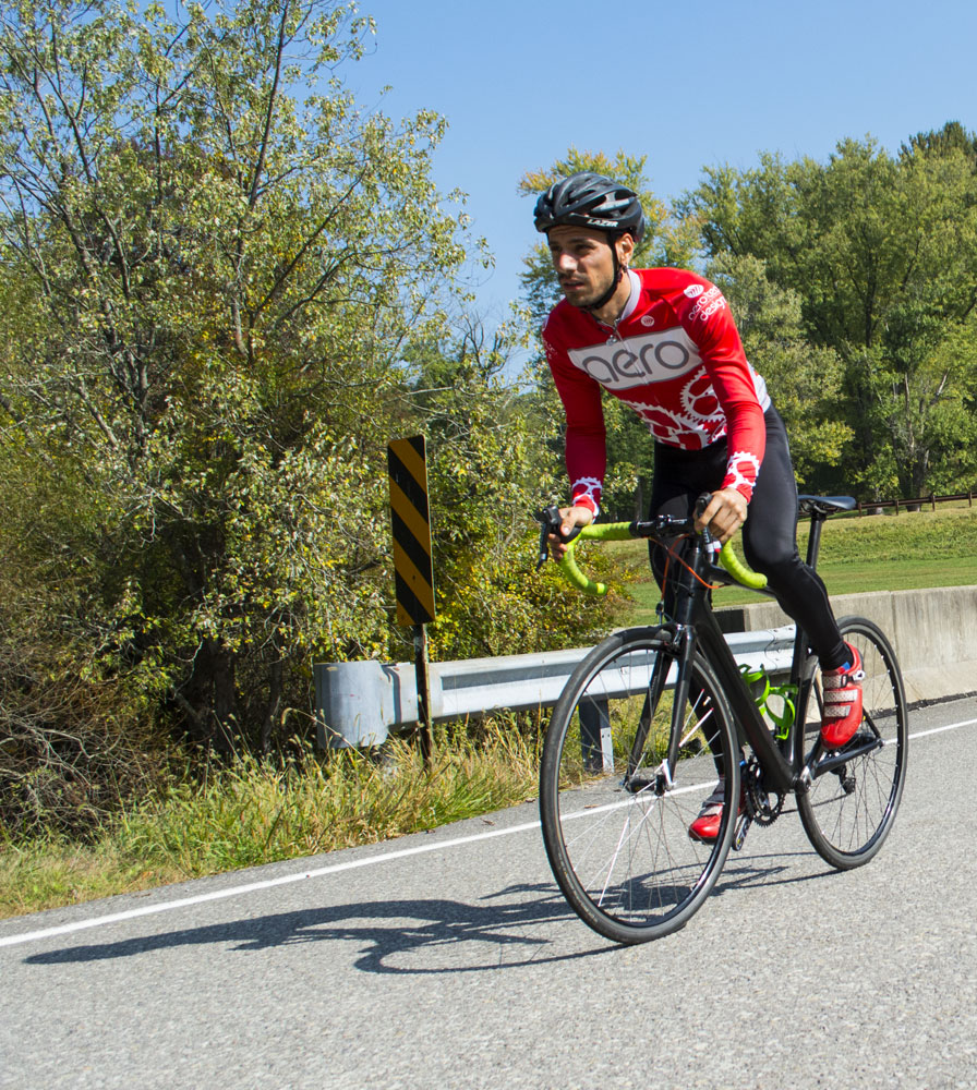 Jordan, professional cyclist. Riding his bicycle on a beautiful fall day with long sleeve cycling apparel.